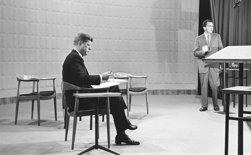 September 26, 1960 NIXON-KENNEDY DEBATE John F. Kennedy, seated at left, and Richard M. Nixon in advance of the first televised presidential debate. Copyright © 1960 CBS Broadcasting Inc. All Rights Reserved. Credit: CBS Photo Archive. File: 20694_163